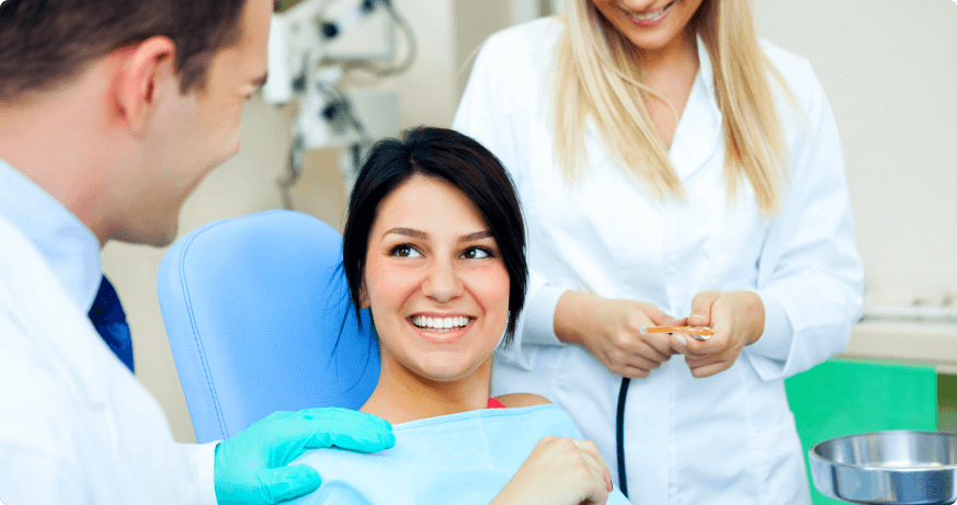 female patient smiling to the dentist